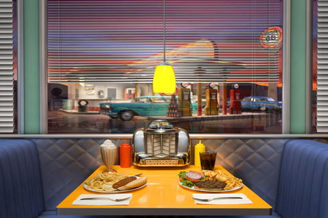 Diner booth with great menu covers in use.