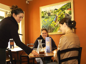 Young women at lunch in a quaint restaurant.