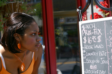 woman studying sidewalk menu