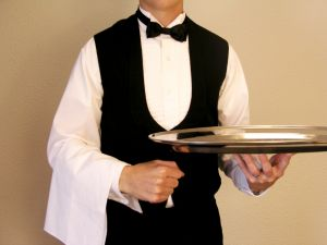 waiter at a table with restaurant table tents from menucoverman.com and table-tents.com